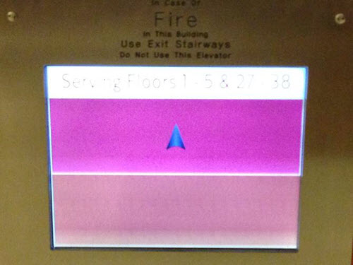 Two color blocks displayed on touch screen with up arrow in a dark pink square and an empty peachy pink block below.