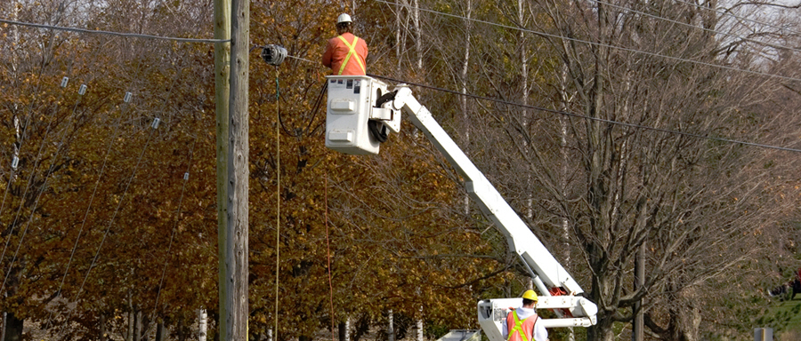 Utility worker fixing electric power line