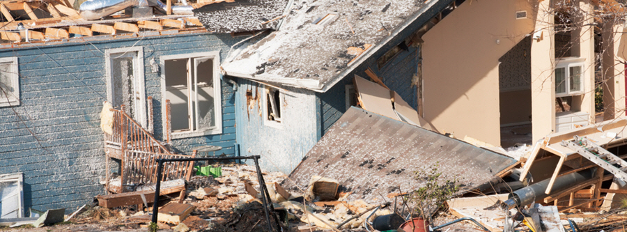 Stock photo of severe damage to a home after a tornado