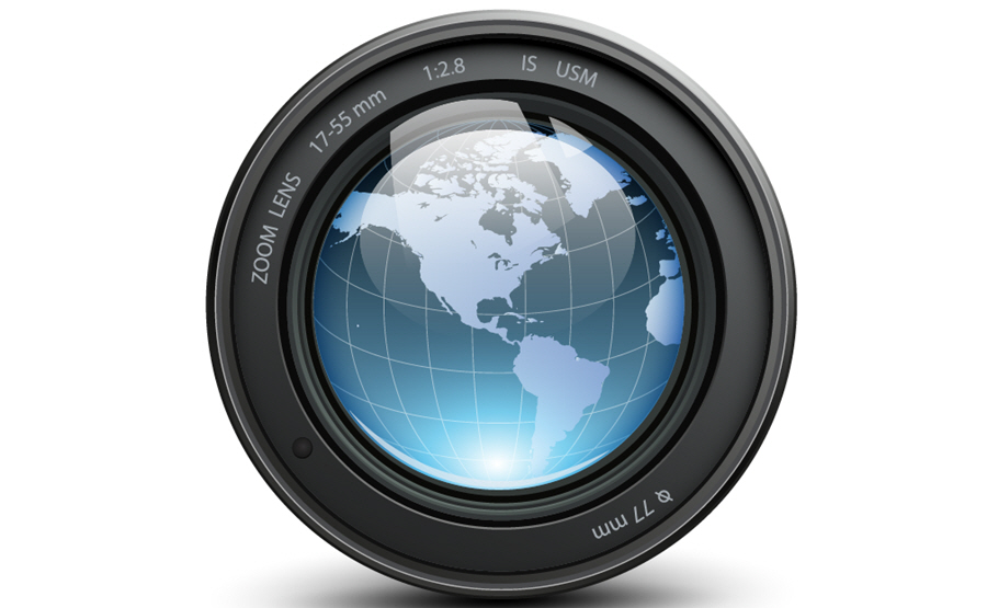 Stock photo of camera lens with a globe inside
