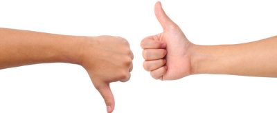 Stock photo of a thumb up and a thumb down