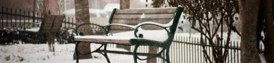 Stock photo of empty bench with snow