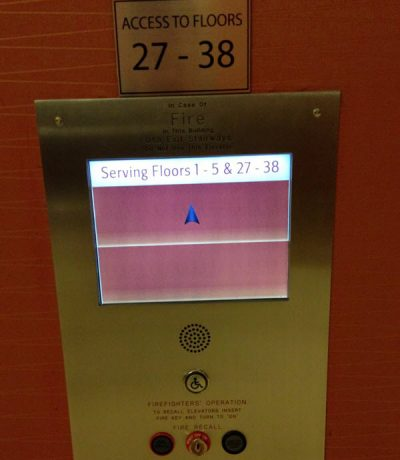 Photograph of the confusing elevator touch screen interface described fully in the text below.