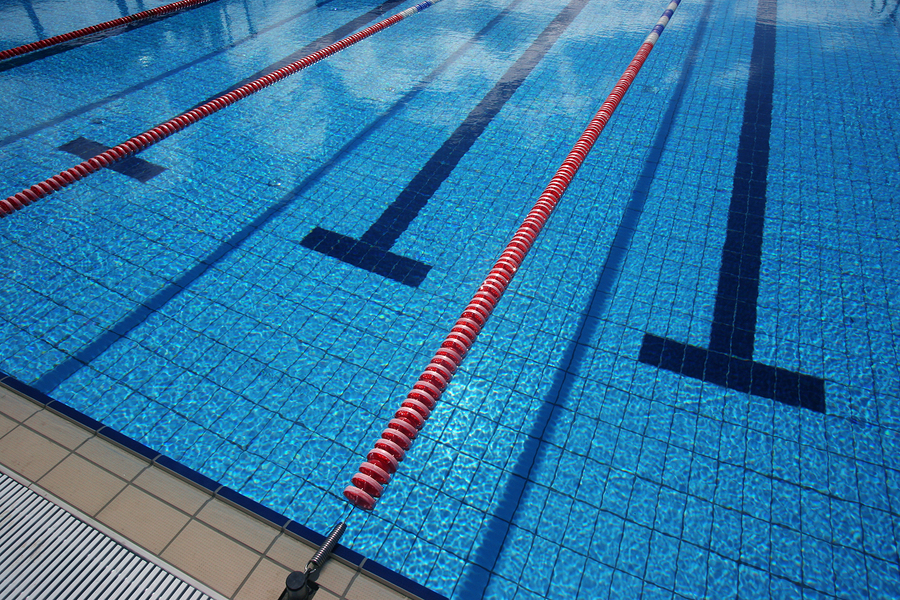 Empty swimming pool with lap lane markers.