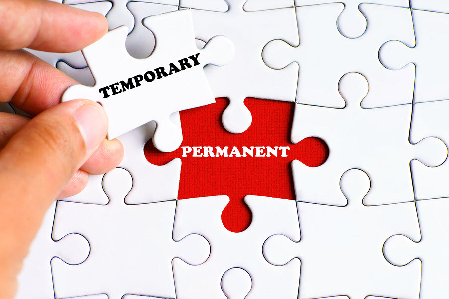 A white completed puzzle with one open red space for a puzzle piece saying permanent but being replaced by a white puzzle piece that says temporary.