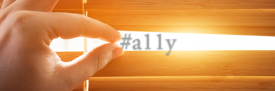 Fingers opening Venetian blind with #a11y coming out from behind the opening.