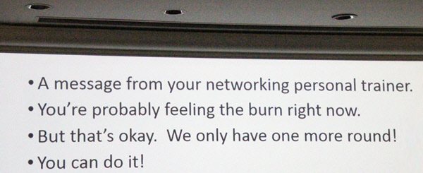 Slide from presentation: A message from your networking personal trainer. You're probably feeling the burn right now. But that's okay. We only have one more round! You can do it!