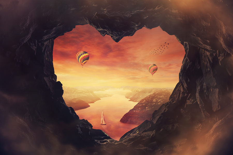 heart shaped cave overlooking a river with mountains, boats and balloons: Bigstockphoto.com / 1STunningArt