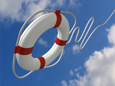 Life preserver in the air below a cloudy sky