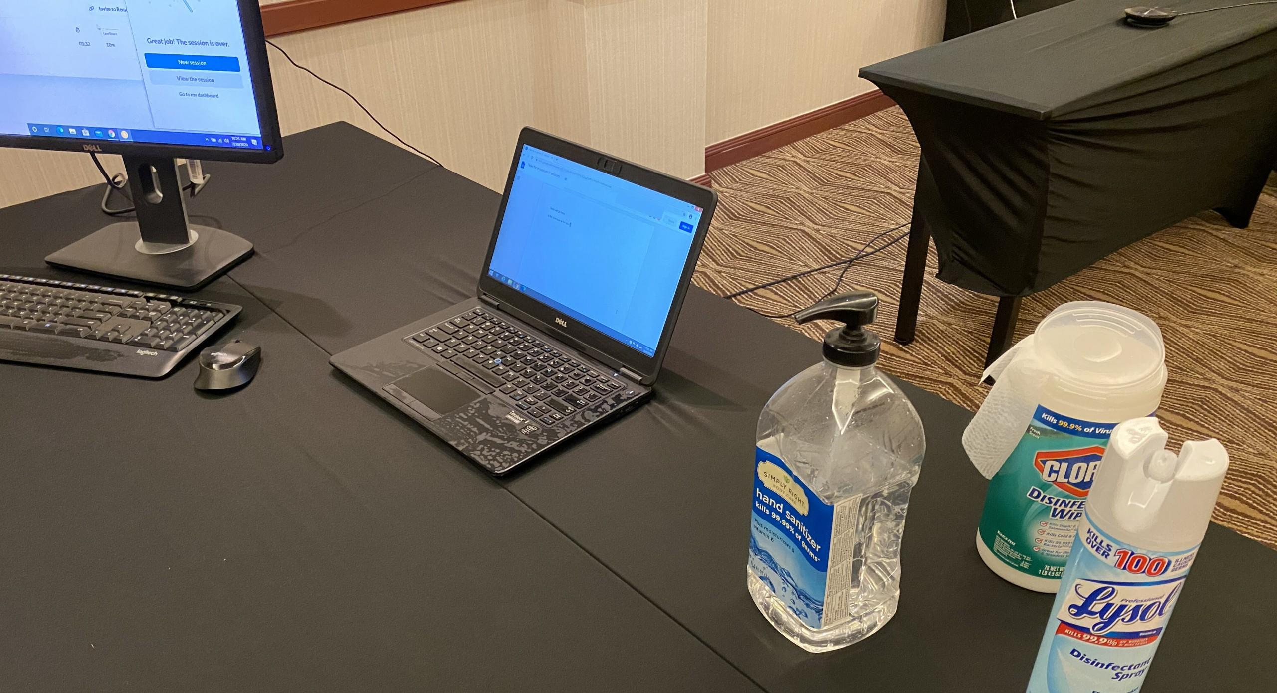 Participant work station with computer, laptop to view tasks, and disinfectant supplies