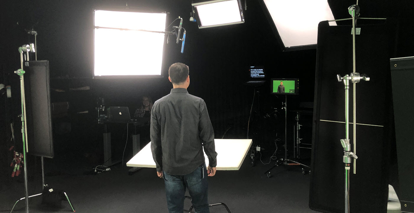 Cory on set at LinkedIn Learning with bright lights in front of him
